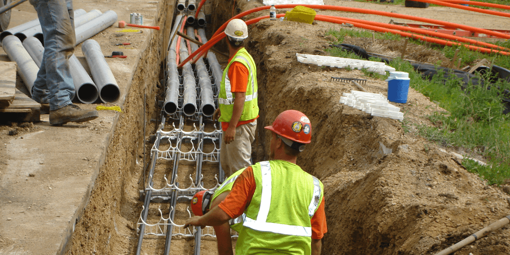 workers installing underground power lines